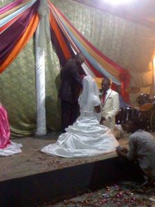 Saying their vows, on their knees