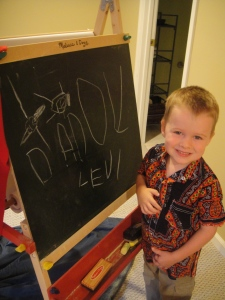 Father's Day drawing for daddy - completely unprompted!  Levi and Daddy can be seen swimming above the D and A...