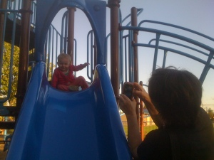 Amelia is addicted to slides - and her great aunt Edie takes a picture.
