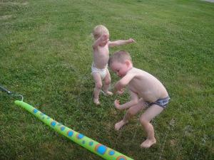 "In KY, the kids beat the heat in the sprinkler.  I call this photo ""Sprinkler Harlem Shake"""