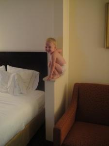 Amelia's hotel antics...she's a climber!