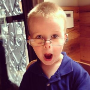 Trying out Daddy's glasses...(photo by Jennifer)