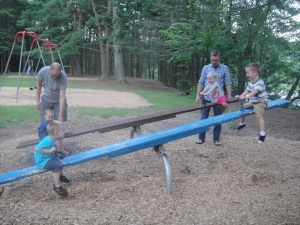 The Dads help with some teeter-totter competitions.