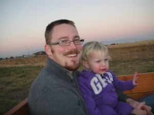 Riding the train.  Amelia MAY still have some pork chop from dinner stuffed in her cheek.