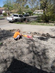 Sliding down the rock pile during our two weeks in Idaho working on the yard
