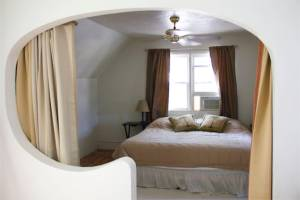 Cozy master bedroom - the curtains help keep the temperature stable - it gets cold or hot up there in the wrong season!