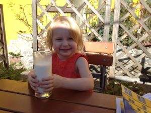 Our little discovered restaurant experience in Germany, Amelia was very happy with her giant glass of milk!