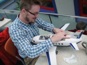 Matthew is an MAF oddity - not a pilot or mechanic…yet here he is, fixing an airplane!