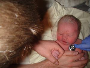 A few minutes after birth, holding Daddy's hand