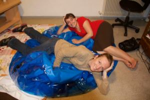 Remember my friend, an MAF wife going to Eastern DRC, who had her baby at home?  Well, this is me and my awesome friend Shannon (an OB who is also going to Congo and helped with the delivery)...we did most of the clean-up and at 4am this is how you deflate a birth pool.