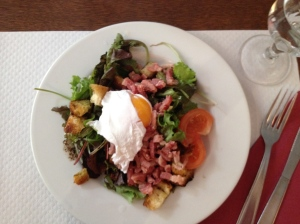 Salade Lyonnaise - delicious with a vinegar dressing and lots of bacon and a poached egg on top!