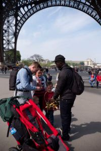 Buying some souvenirs under the Eiffel Tower