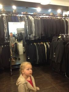 Watching Daddy buy a lightweight (heavily discounted) Italian suit for important business meetings Congo.