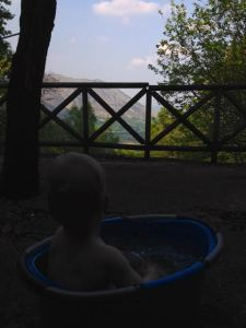 Axel pondering the wonders of the Italian Alps from our cabin.